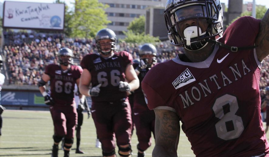 Montana running back Travon Van (8) celebrates after scoring a touchdown against Central Washington during the first half of an NCAA college football game Saturday, Sept. 6, 2014, in Missoula, Mont. (AP Photo/Montana Kaimin, Jacob Green)