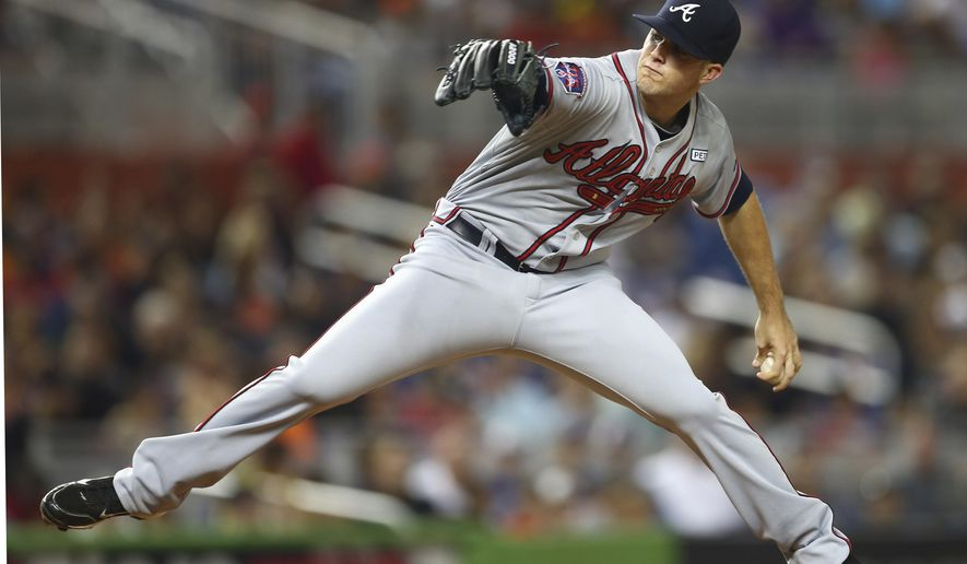 Atlanta Braves starter Alex Wood pitches to the Miami Marlins during the second inning of a baseball game in Miami, Saturday, Sept. 6, 2014.  (AP Photo/J Pat Carter)