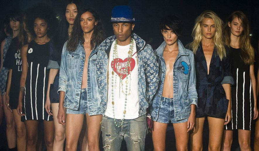 Pharrell Williams reveals the Raw for the Oceans Spring/Summer 2015 collection presented by G-Star RAW and Bionic during Fashion Week on Friday, Sept. 5, 2014 in New York. (Photo by Charles Sykes/Invision/AP)