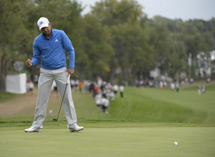 Sergio Garcia pumps his fist as he watches his birdie putt go in on No. 18 during the second round of the BMW Championship golf tournament, Friday, Sept. 5, 2014, in Cherry Hills Village, Colo. (AP Photo/The Denver Post, John Leyba)