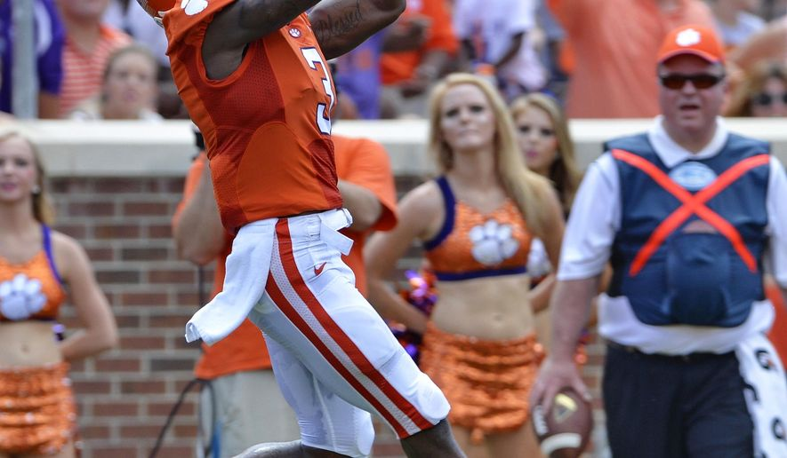 Clemson's Artavis Scott pulls in a reception for a touchdown in the second quarter of an NCAA college football game against South Carolina State in Clemson, S.C.,  Saturday, Sept. 6, 2014.  (AP Photo/ Richard Shiro)