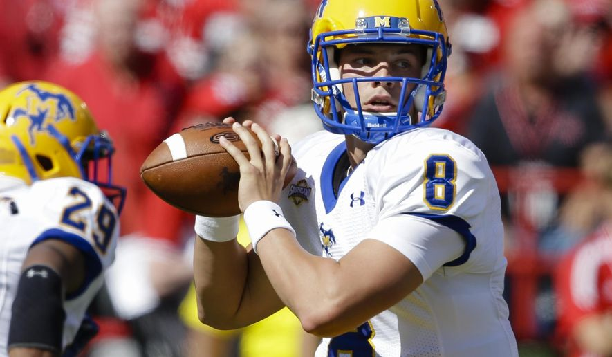 McNeese State quarterback Tyler Bolfing (8) throws in the first half of an NCAA college football game against Nebraska in Lincoln, Neb., Saturday, Sept. 6, 2014. (AP Photo/Nati Harnik)