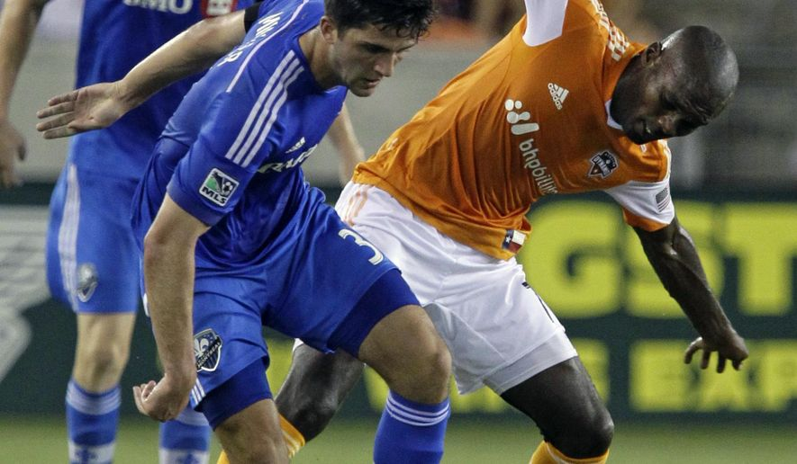 Montreal Impact  Eric Miller, left, is challenged by Houston Dynamo Omar Cummings, right, during the first half of a soccer game at BBV Compass Stadium Saturday, Sept. 6, 2014, in Houston.(AP Photo/Houston Chronicle, Melissa Phillip)