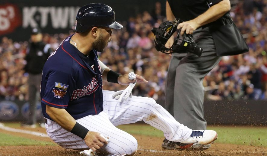 Minnesota Twins' Josmil Pinto scores a tying run on a single by Aaron Hicks off Los Angeles Angels pitcher Hector Santiago in the fourth inning of a baseball game, Friday, Sept. 5, 2014, in Minneapolis. (AP Photo/Jim Mone)