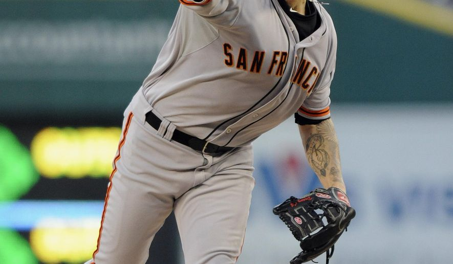 San Francisco Giants pitcher Jake Peavy throws against the Detroit Tigers in the first inning of a baseball game Friday, Sept. 5, 2014, in Detroit. (AP Photo/Jose Juarez)