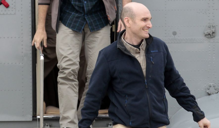 FILE - In this Sunday April 20, 2014 file photo, released French hostage Nicolas Henin arrives at the Villacoublay military airbase, outside Paris. A French journalist held hostage for months by extremists in Syria says one of his captors was a Frenchman suspected of killing four people at the Brussels Jewish Museum earlier this year. French magazine Le Point on Saturday, Sept. 6, 2014, quotes its reporter Nicolas Henin as saying he was tortured by Mehdi Nemmouche, a Frenchman who had spent time with extremists in Syria. Henin was held for a time with American journalists James Foley and Steven Sotloff, both beheaded by extremists from the Islamic State group in recent weeks. He was released in April with other French journalists who had been held since June 2013. Nemmouche is in custody since his arrest in France soon after the Brussels killing in May. The attack crystallized fears of European governments that Europeans who join radical fighters in Syria could return to stage attacks at home. (AP Photo/Jacques Brinon, file)
