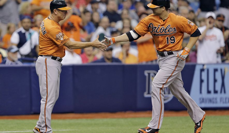 Baltimore Orioles' Chris Davis (19) shakes hands with third base coach Bobby Dickerson after hitting a home run off Tampa Bay Rays starting pitcher Drew Smyly during the second inning of a baseball game Saturday, Sept. 6, 2014, in St. Petersburg, Fla. (AP Photo/Chris O'Meara)