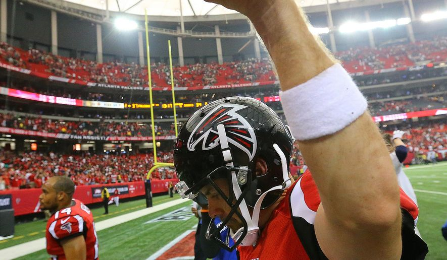 Atlanta Falcons kicker Matt Bryant holds the game ball in the air after kicking the game-winning field goal in overtime to beat the Saints 37-34  in an NFL football game Sunday, Sept. 7, 2014, in Atlanta.   (AP Photo/Atlanta Journal-Constitution, Curtis Compton)  MARIETTA DAILY OUT; GWINNETT DAILY POST OUT; LOCAL TELEVISION OUT; WXIA-TV OUT; WGCL-TV OUT