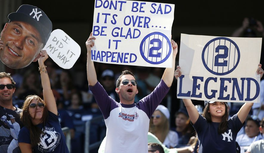 Fans of New York Yankees' Derek Jeter (2) hold signs before a pregame ceremony honoring the Yankees captain who is retiring at the end of the season, on Derek Jeter Day at Yankee Stadium in New York, Sunday, Sept. 7, 2014.  game (AP Photo/Kathy Willens)