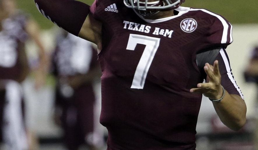 Texas A&M quarterback Kenny Hill (7) throws a pass against Lamar during the second quarter of an NCAA college football game Saturday, Sept. 6, 2014, in College Station, Texas. (AP Photo/David J. Phillip)