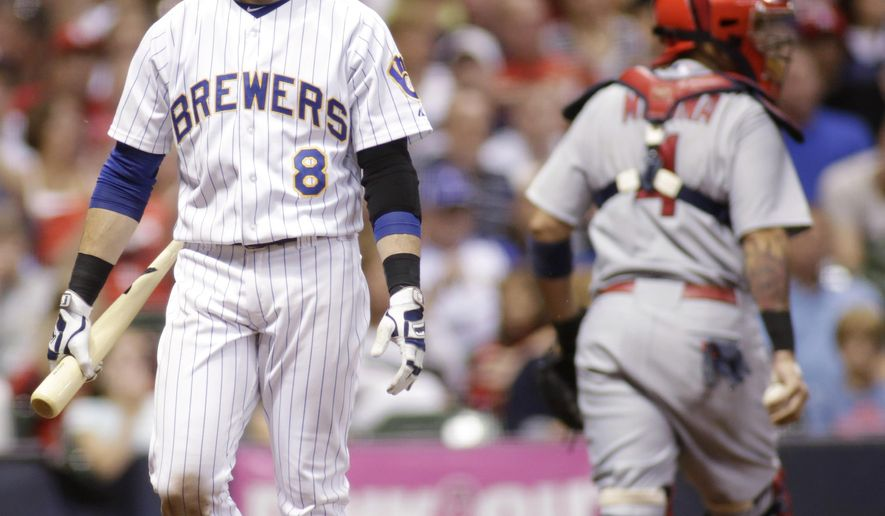 Milwaukee Brewers' Ryan Braun reacts after striking out looking against the St. Louis Cardinals during the seventh inning of a baseball game Saturday, Sept. 6, 2014, in Milwaukee. (AP Photo/Darren Hauck)