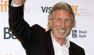 "Roger Waters waves as he arrives for the premiere of ""Roger Waters: The Wall"" at the Toronto International Film Festival in Toronto on Saturday, Sept. 6, 2014. (AP Photo/The Canadian Press, Frank Gunn)"