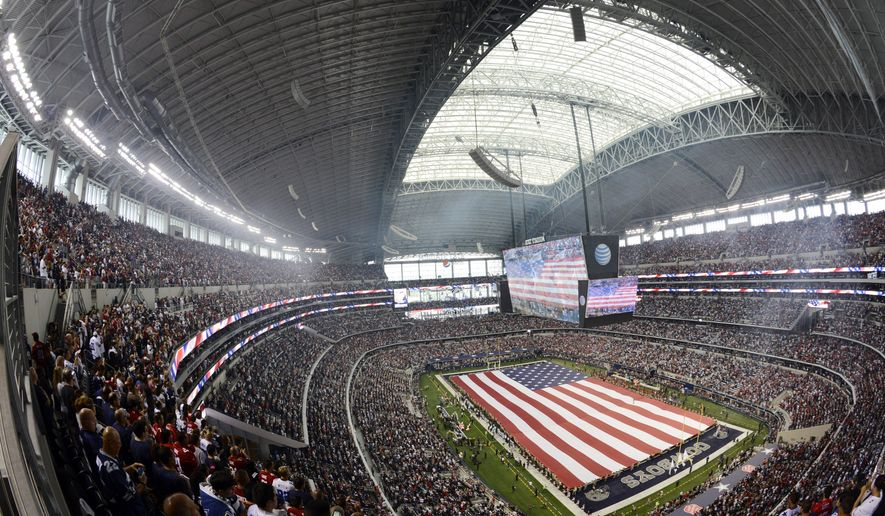 Members of the U.S. military present the American flag before the first half of an NFL football game between the Dallas Cowboys and the San Francisco 49ers, Sunday, Sept. 7, 2014, in Arlington, Texas. (AP Photo/Tim Sharp)