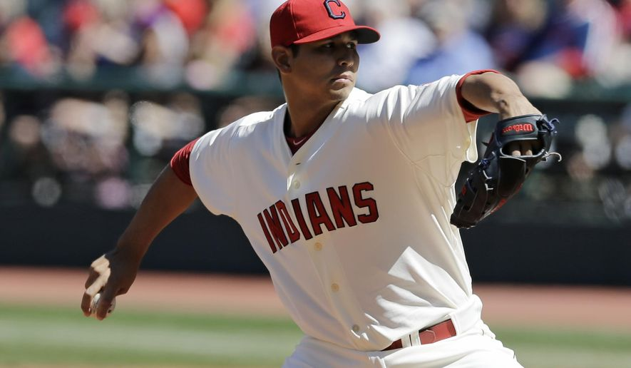 Cleveland Indians starting pitcher Carlos Carrasco delivers in the first inning of a baseball game against the Chicago White Sox, Sunday, Sept. 7, 2014, in Cleveland. (AP Photo/Tony Dejak)