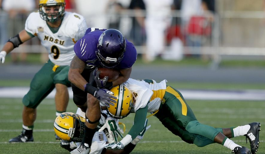 North Dakota State University's Carlton Littlejohn, left, and Tre Dempsey tackle Weber State's Zach Smith during an NCAA college football game, Saturday, Sept. 6, 2014 in Ogden, Utah. (AP Photo/Standard-Examiner, ) TV OUT; MANDATORY CREDIT