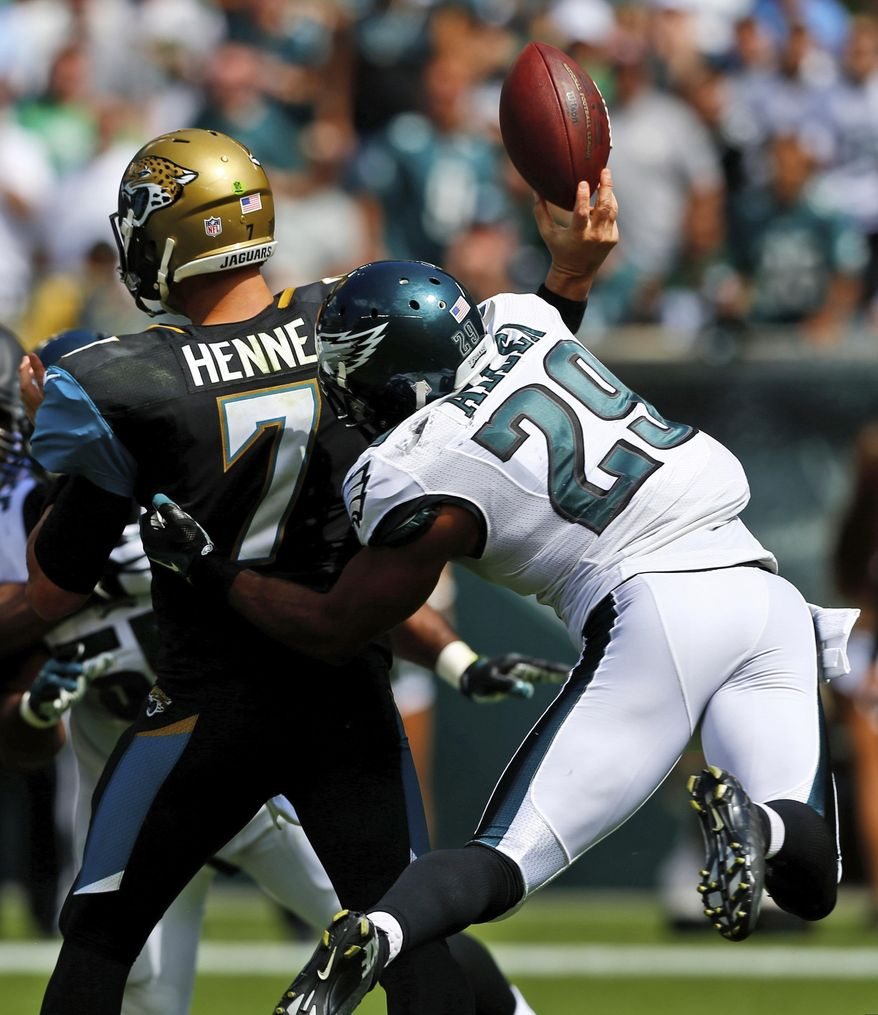 Philadelphia Eagles' Nate Allen, right, knocks the ball loose from Jacksonville Jaguars' Chad Henne during the first half of an NFL football game, Sunday, Sept. 7, 2014, in Philadelphia. (AP Photo/Michael Perez)