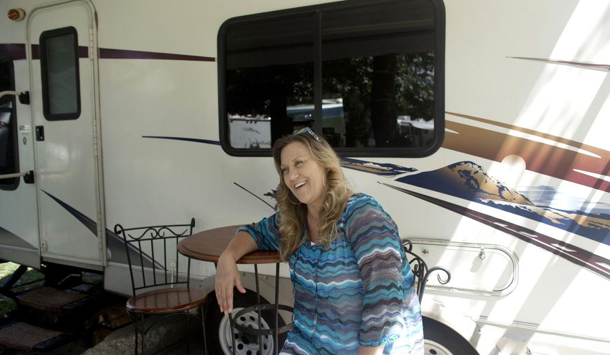 FOR RELEASE SUNDAY, SEPTEMBER 7, 2014, AT 9:00 A.M. EDT - In this Aug. 26, 2014 photo, Sally Carpenter speaks outside her trailer at a campground at Joint Expeditionary Base Little Creek-Fort Story in Norfolk, Va. Sally has been staying at the camp ground on and off since Jan. 2014 waiting for her husband's retirement. (AP Photo/The Virginian-Pilot, L. Todd Spencer)  MAGS OUT