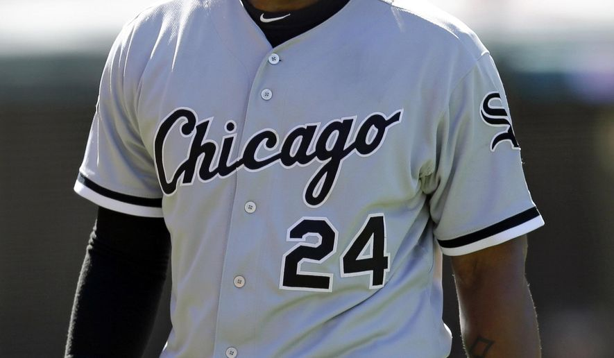 Chicago White Sox's Dayan Viciedo walks back to the dugout after striking out against Cleveland Indians starting pitcher Carlos Carrasco in the eighth inning of a baseball game, Sunday, Sept. 7, 2014, in Cleveland. The Indians defeated the White Sox 2-0. (AP Photo/Tony Dejak)