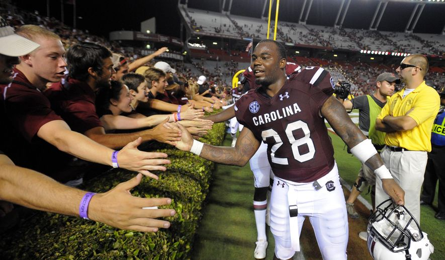 South Carolina running back Mike Davis (28) celebrates with fans at the end of an NCAA college football game against the East Carolina, Saturday, Sept. 6, 2014, in Columbia, S.C. South Carolina won 33-23. (AP Photo/Stephen B. Morton)