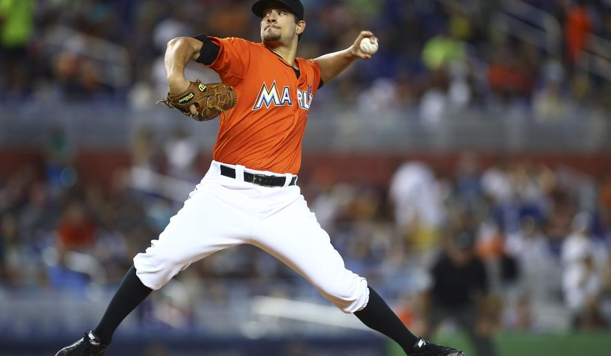 Miami Marlins starter Brad Hand pitches to the Atlanta Braves during the second inning of a baseball game in Miami, Sunday, Sept. 7, 2014.   (AP Photo/J Pat Carter)