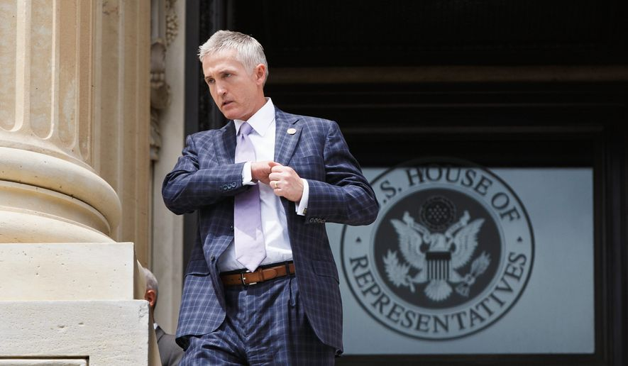 Rep. Trey Gowdy, R-S.C., chairman of the newly-formed Select Committee on Benghazi, walks down the steps of the House of Representatives on Capitol Hill in Washington, Friday, May 30, 2014, after final votes. (AP Photo/J. Scott Applewhite)