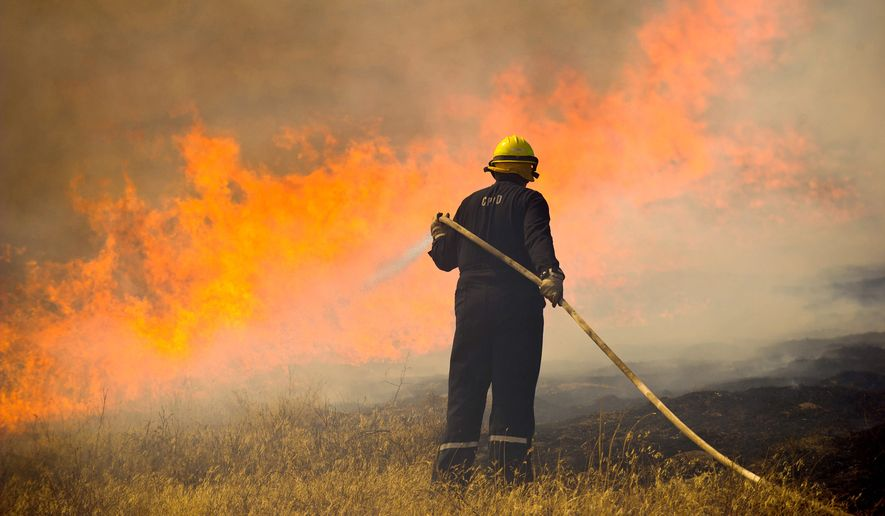Rich Guse of the College Place, Washington, Fire Department works a wildfire site. (associated press/walla walla union-bulletin)