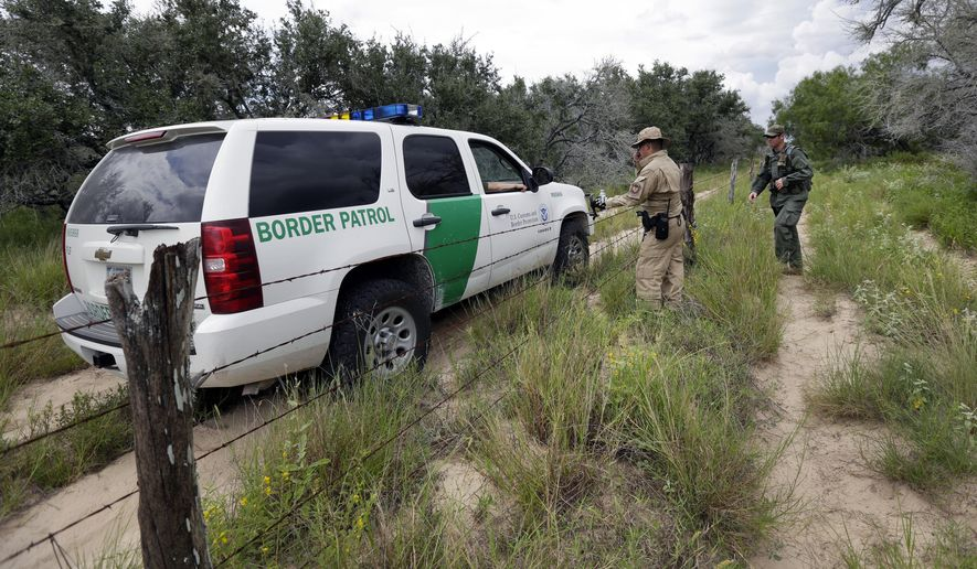 In this Sept. 5, 2014 photo, a U.S. Customs and Border Protection Air and Marine agents and U.S. Customs and Border Protection agents compare notes as they patrol near the Texas-Mexico border, near McAllen, Texas. Since illegal immigration spiked in the Rio Grande Valley this summer, the Border Patrol has dispatched more agents, the Texas Department of Public Safety has sent more troopers and Gov. Rick Perry deployed as many as 1,000 guardsmen to the area. (AP Photo/Eric Gay)