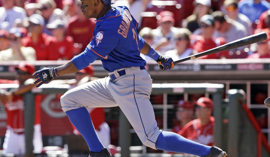 New York Mets' Curtis Granderson gets a hit off Cincinnati Reds starting pitcher Mat Latos to drive in a run in the sixth inning of a baseball game, Sunday, Sept. 7, 2014, in Cincinnati. (AP Photo/Al Behrman)