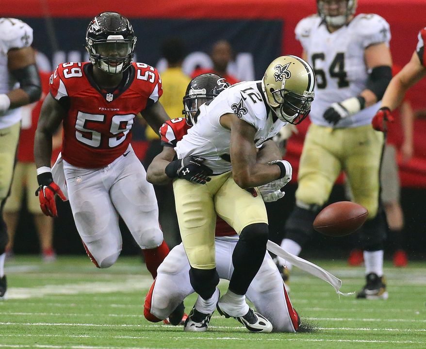Falcons safety William Moore strips Saints wide receiver Marques Colston causing a fumble recovered by the Falcons in overtime in their NFL football game on Sunday, Sept. 7, 2014, in Atlanta. Falcons linebacker Joplo Bartu, left, recovered the fumble. The Falcons went on to kick a fieldgoal to win the game 37-34.    (AP Photo/Atlanta Journal-Constitution, Curtis Compton)  MARIETTA DAILY OUT; GWINNETT DAILY POST OUT; LOCAL TELEVISION OUT; WXIA-TV OUT; WGCL-TV OUT