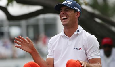 Billy Horschel jokes with members of his threesome while waiting to tee off on the third hole in the final round of the BMW Championship golf tournament in Cherry Hills Village, Colo., on Sunday, Sept. 7, 2014. (AP Photo/David Zalubowski)