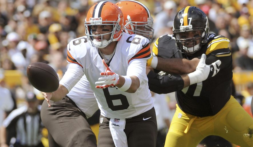 Cleveland Browns quarterback Brian Hoyer (6) pitches out as Pittsburgh Steelers defensive end Cameron Heyward (97) pressures in the first quarter of the NFL football game on Sunday, Sept. 7, 2014 in Pittsburgh. (AP Photo/Don Wright)