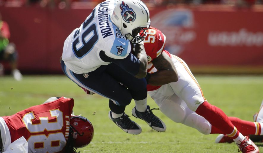 Tennessee Titans running back Leon Washington (29) is tackled by Kansas City Chiefs defensive back Ron Parker (38) and linebacker Derrick Johnson (56) in the first half of an NFL football game in Kansas City, Mo., Sunday, Sept. 7, 2014. (AP Photo/Charlie Riedel)