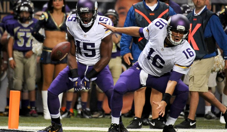 Minnesota Vikings quarterback Matt Cassel, right, celebrates after throwing an 8-yard touchdown pass to wide receiver Greg Jennings, left, during the second quarter an NFL football game against the St. Louis Rams, Sunday, Sept. 7, 2014, in St. Louis. (AP Photo/L.G. Patterson)