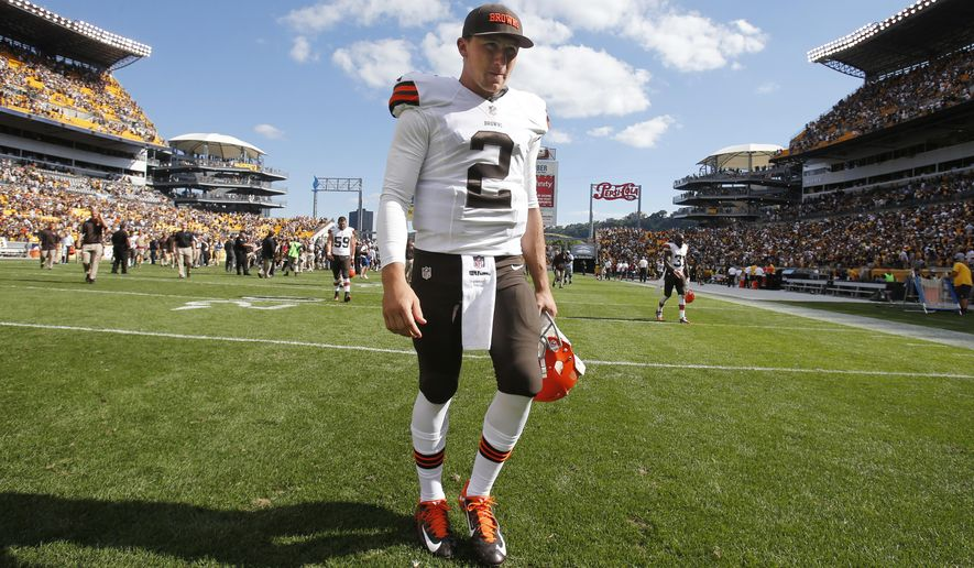 Cleveland Browns quarterback Johnny Manziel walks off the field after a 30-27 loss to the Pittsburgh Steelers in an NFL football game in Pittsburgh, Sunday, Sept. 7, 2014. Manziel did not see action in the game. (AP Photo/Gene J. Puskar)
