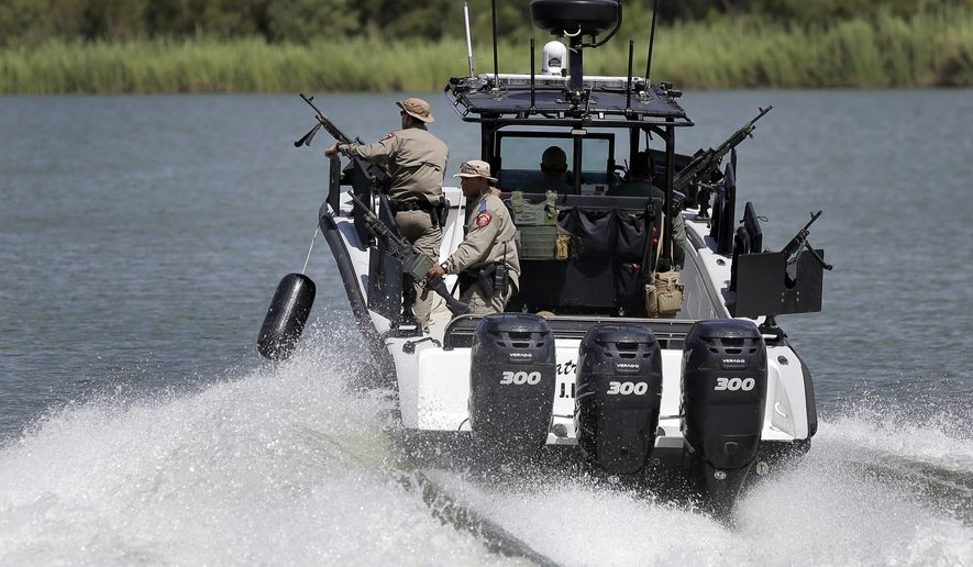 Texas Department of Safety Troopers patrol on the Rio Grande along the U.S.-Mexico border, Saturday, Sept. 6, 2014, in Mission, Texas. Since illegal immigration spiked in the Rio Grande Valley this summer, the Border Patrol has dispatched more agents, the Texas Department of Public Safety has sent more troopers and Texas Gov. Rick Perry deployed as many as 1,000 guardsmen to the area. (AP Photo/Eric Gay)