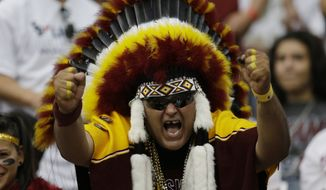 A Washington Redskins fan cheers during the second quarter of an NFL football game Sunday, Sept. 7, 2014, in Houston. (AP Photo/David J. Phillip) ** FILE **