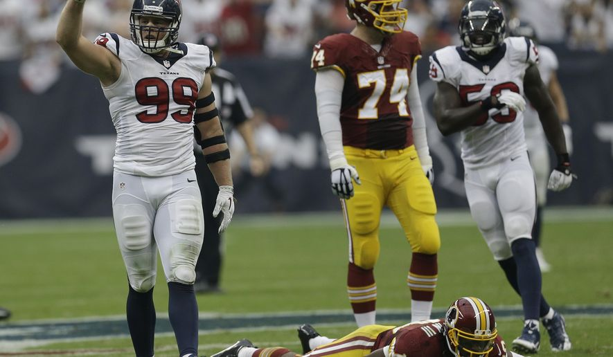 Houston Texans defensive end J.J. Watt (99) celebrates after a hit on Washington Redskins quarterback Robert Griffin III (10) during the second quarter of an NFL football game Sunday, Sept. 7, 2014, in Houston. (AP Photo/David J. Phillip)