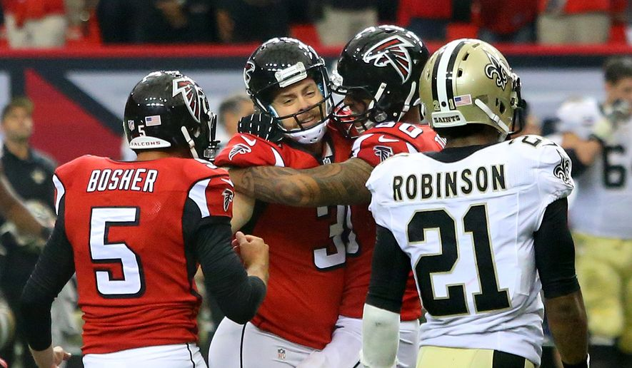 Atlanta Falcons kicker Matt Bryant, second from left, celebrates his field goal in overtime with Matt Bosher (5) and Levine Toilolo (right) that beat the New Orleans Saints 37-34  while Saints Partrick Robinson walks off the field after their NFL football game on Sunday, Sept. 7, 2014, in Atlanta.   (AP Photo/Atlanta Journal-Constitution, Curtis Compton)