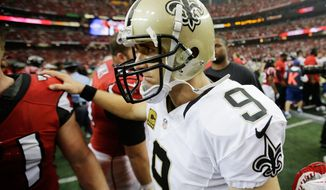 New Orleans Saints quarterback Drew Brees walks across the field after the Saints lost 37-34 in overtime to the Atlanta Falcons in an NFL football game, Sunday, Sept. 7, 2014, in Atlanta. (AP Photo/David Goldman)