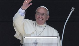Pope Francis waves from his studio window overlooking St. Peter's Square at the Vatican during the Angelus prayer, Sunday, Sept. 7, 2014. (AP Photo/Alessandra Tarantino)