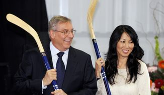 FILE - In this April 13, 2013, file photo, Buffalo Sabres' owner Terry Pegula and his wife, Kim Pegula, pose for cameras during groundbreaking ceremonies at First Niagara Center in Buffalo, N.Y. The next step in the sale of the Buffalo Bills happens on Monday, Sept. 8, 2014, when prospective ownership groups face a deadline to submit their formal bids. Buffalo Sabres owners Terry and Kim Pegula are among at least three candidates still in the running to buy the franchise, which is for sale after Hall of Fame owner Ralph Wilson died in March.(AP Photo/Gary Wiepert, File)