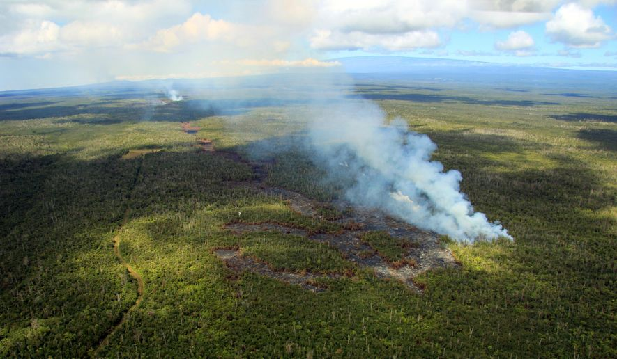 In this Sept. 6, 2014 aerial photo provided by the U.S. Geological Survey, lava advances from the Kilauea volcano in Pahoa, Hawaii. Lava issued from several spots along a deep ground crack earlier this week, as shown by the distinct fingers of lava making up the flow front. The thick smoke plumes show the flow front moving downslope towards the north. Lava from one of the world's most active volcanos has been advancing at a slower pace the past few days and is now moving parallel to a sparsely populated subdivision on Hawaii's Big Island. Hawaii County Civil Defense Director Darryl Oliveira says the lava from Kilauea volcano is still at least a mile away from any homes in Kaohe Homesteads. (AP Photo/Tim Orr, U.S. Geological Survey)