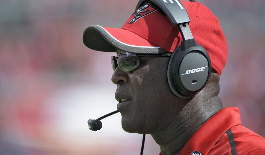 FILE - In this Sept. 7, 2014, file photo, Tampa Bay Buccaneers head coach Lovie Smith looks on from the sidelines during the first half of an NFL game against the Carolina Panthers in Tampa, Fla. The Buccaneers did little right during a season-opening loss to Carolina, yet still had a chance to beat the Panthers. That gives coach Smith and his players something to build on going forward. (AP Photo/Phelan M. Ebenhack, File)
