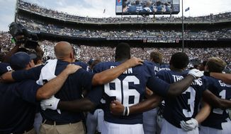 Penn State head football coach James Franklin, second from left, joins his team and fans in singing the Penn State alma mater after a 21-3 win over Akron in an NCAA college football game at Beaver Stadium in State College, Pa., Saturday, Sept. 6, 2014. (AP Photo/Gene J. Puskar)