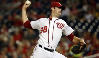 Washington Nationals starting pitcher Doug Fister throws during the third inning of a baseball game Atlanta Braves at Nationals Park, Monday, Sept. 8, 2014, in Washington. (AP Photo/Alex Brandon)