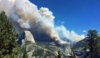 In this photo provided by Yosemite National Park, smoke from a fire rises above Little Yosemite Valley near Yosemite National Park, Calif., Sunday, Sept. 7, 2014. About 100 Yosemite National Park visitors were evacuated by helicopter Sunday when a wildfire that started weeks ago in the park's backcountry grew unexpectedly to at least 700 acres, officials said. (AP Photo/Yosemite National Park)
