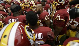Washington Redskins' Adam Hayward (55) rallies teammates before an NFL football game against the Houston Texans, Sunday, Sept. 7, 2014, in Houston. (AP Photo/David J. Phillip)