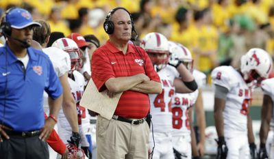 SMU head coach June Jones watches from the sidelines during the first half of an NCAA college football game against Baylor, Sunday, Aug. 31, 2014, in Waco, Texas. (AP Photo/LM Otero)