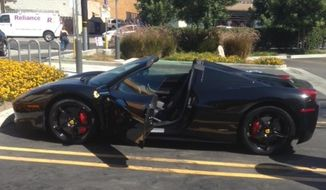 This taken on Thursday, Sept. 4, 2014 photo and provided by the Fontana (Calif.) Police Department on Tuesday, Sept. 9, 2014, shows a stolen 2014 Ferrari 458 Spider. The Riverside Press-Enterprise reported that Fontana Police arrested Earnie Hooks, of Los Angeles, for stealing the same Ferrari, twice. Court records say he's pleaded not guilty to car theft and resisting police.  (AP Photo/Fontana Police Department)