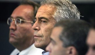 """Jeffrey Epstein (center), who pleaded guilty in 2008 to soliciting sex from an underage girl, had what appears to be a purely social relationship with Donald Trump — a link that is far short of former President Bill Clinton's 20-plus plane rides on his """"Lolita Express"""" private jet around the globe in the early 2000s. (Associated Press/File)"""
